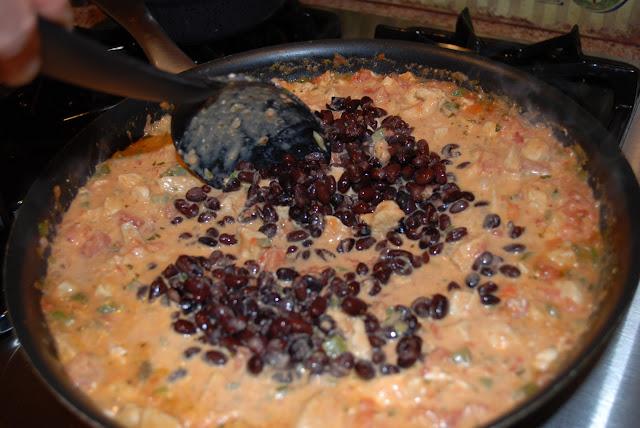 stirring in beans