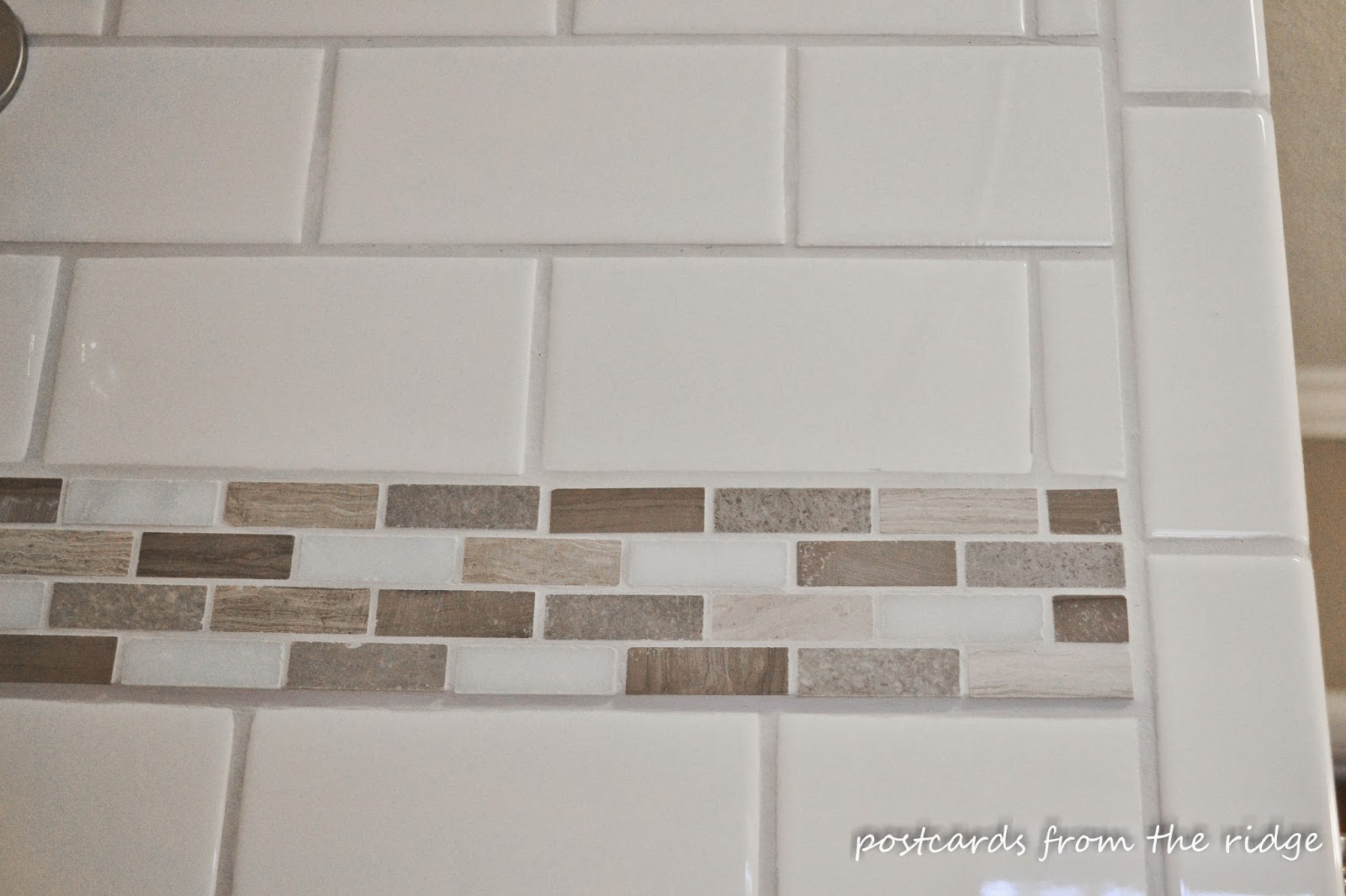 I love this accent tile!  Lots of other great bathroom ideas here!