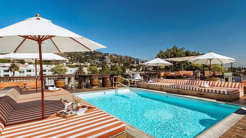 Petit Ermitage hotel poolside