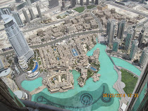 Looking down on skyscrapers from observation deck (124th floor) of Burj Khalifa, Dubai, U.A.E.