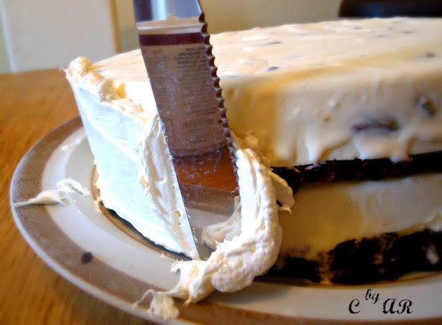 Frosting ice cream cake with flat knife