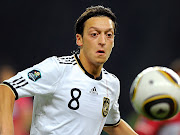 Fresh from a record breaking season with Real Madrid, the googly eyed, . (mesut ozil)