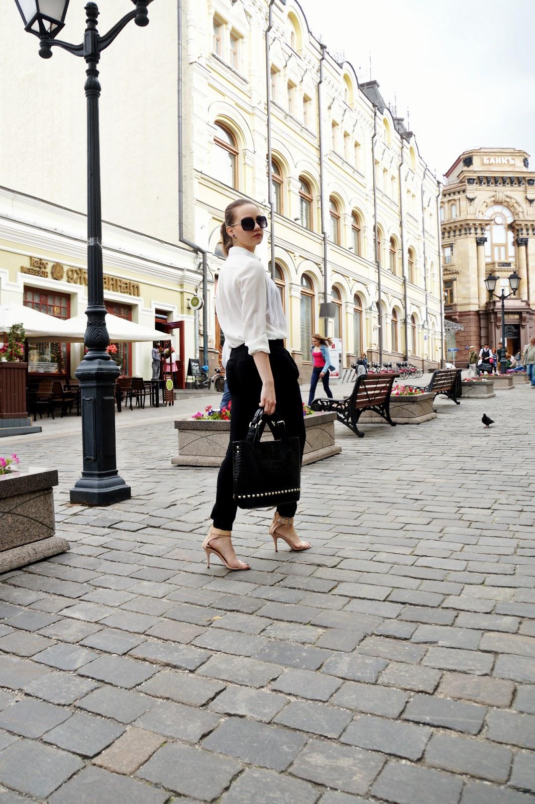 White blouse, black pants, nude heels