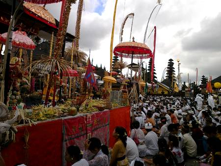 Balinese people pray at the temple.