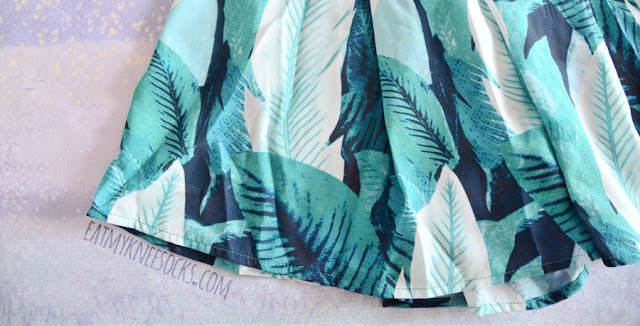 WalkTrendy's aqua/teal leaf floral patterned two-piece set includes flowy printed shorts.