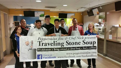 Image of Rio Salado Sustainable Food Systems team at Cafe @ Rio holding up a Traveling Stone Soup sign