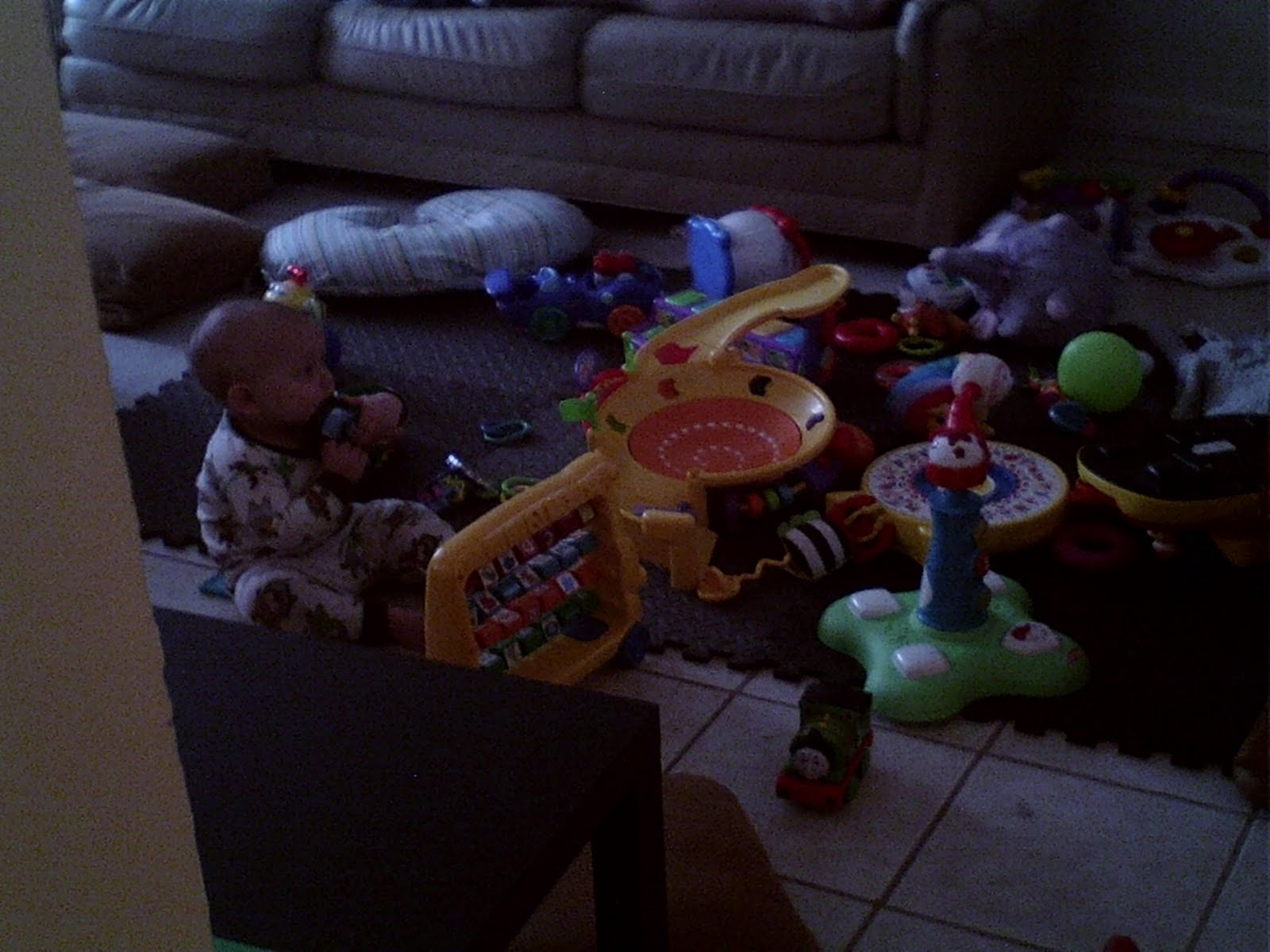 Wordless Wednesday picture of our baby playing with toys, beautiful baby mess poem