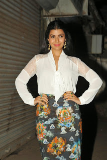 Nimrat Kaur Airlift Actress of Akshay Kumar looks cute and beautiful in whtie Top and Printed skirt