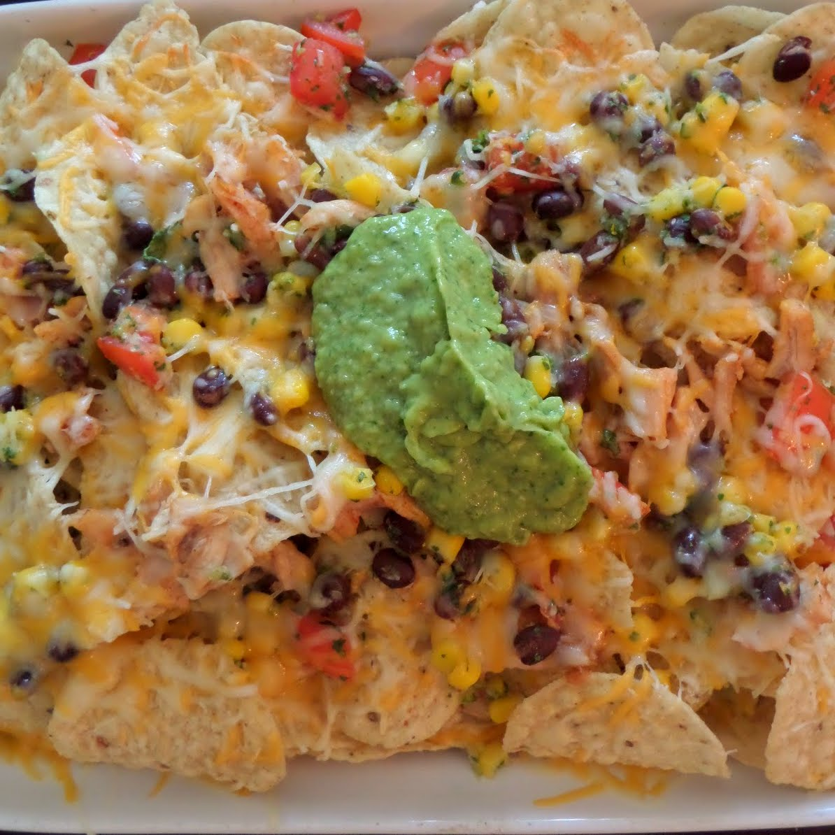 Chicken and Black Bean Salsa Nachos:  Crunchy tortilla chips layered with leftover rotisserie chicken, black bean and corn salsa, and shredded cheese.