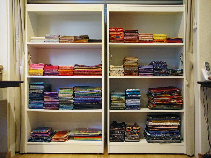 frabric storage system: Front shelf units filled with cotton batiks and prints