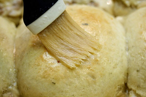 brushing-baked-rolls-with-butter