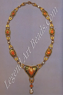 An enameled necklace designed by Louis Comfort Tiffany, set with Mexican opals and pearls (c. 1905). Virginia Museum of Fine Arts, Gift of Sydney and Frances Lewis