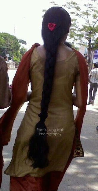 Neatly made long hair braid decorated with rose flower by Chennai girl.