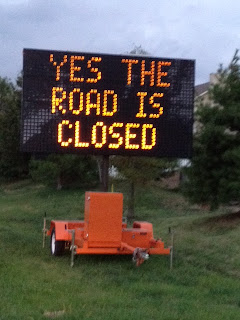 Digital road sign, message reads Yes,the road is closed.