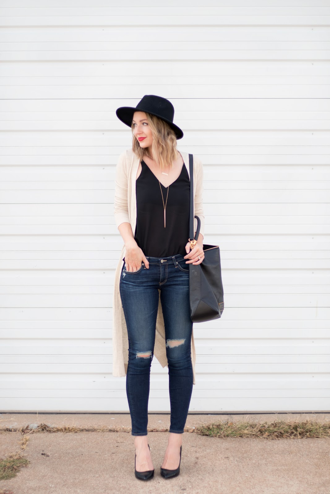 Long cardigan layered over jeans and a tank