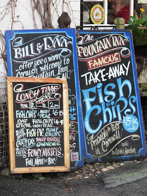 Traditional fish and chips signs in Mevagissey Cornwall