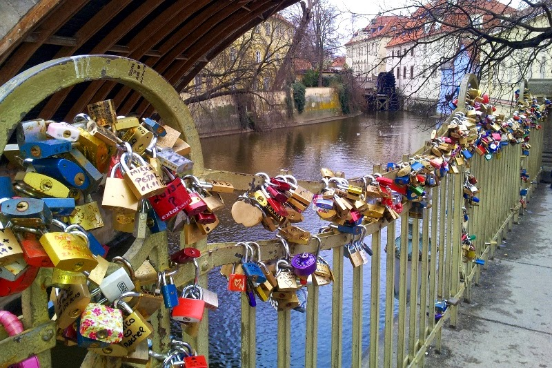 love lock on a railing under the Charles bridge Prague