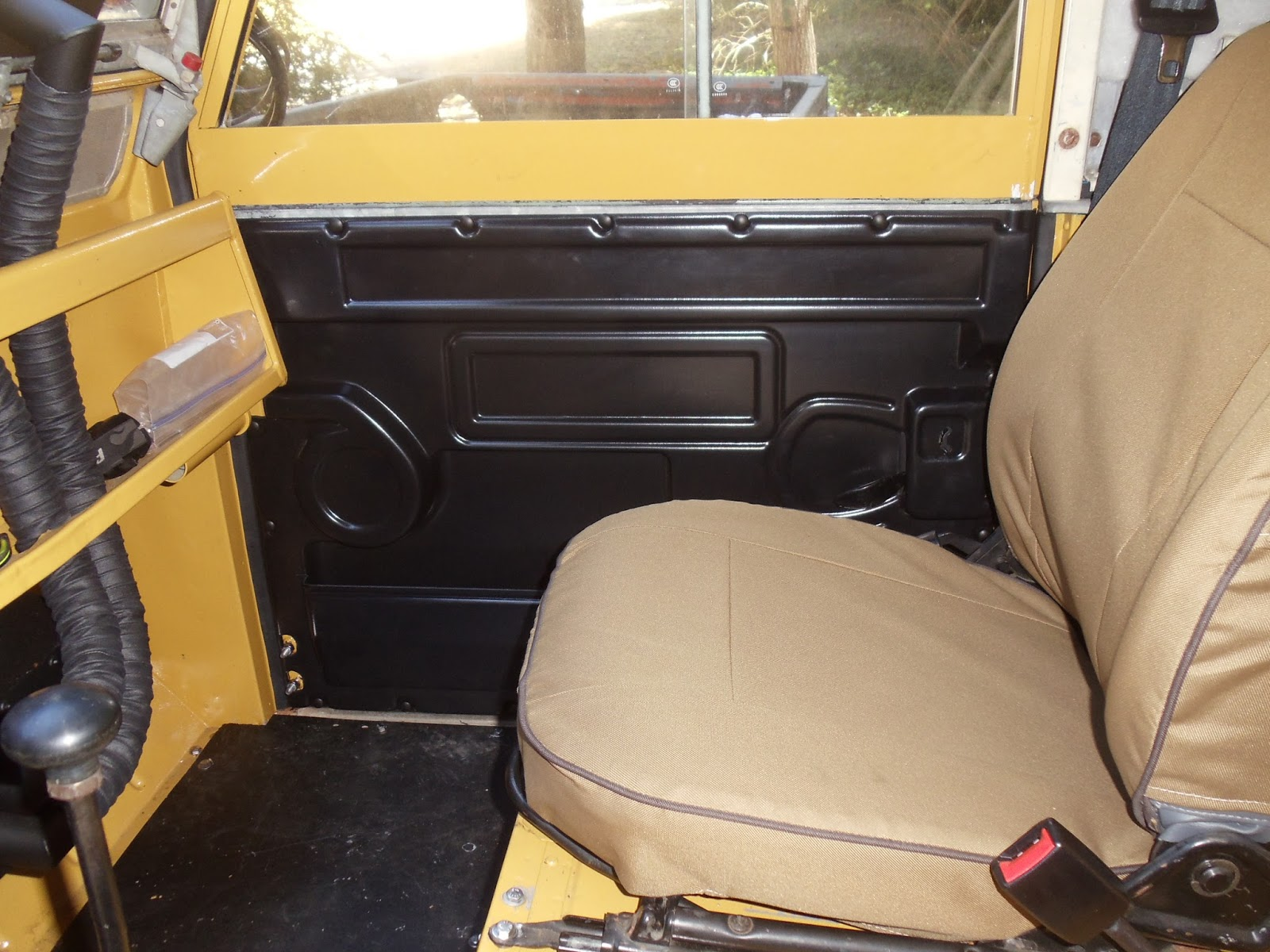 I used wood cl&s to hold the card to the door while I drilled holes and put in screws. The spare tyre was set in place on the inside tray. & Genocache: Land Rover 109 runs...sort of