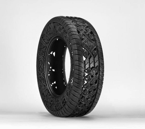 wim-delvoyes-incredible-rubber-carvings-turn-tires-into-art 2