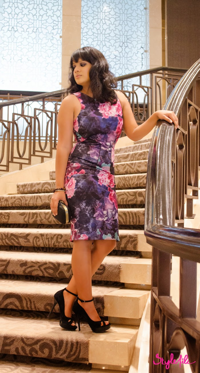 Dayle Pereira of Style File India wears a Miss Selfridge bodycon dress via Jabong with Zara stilettos, Accessorize bracelets and a minaudiere on the stairs