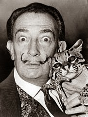 Salvador Dalí with animal-printed cat. (Okay, ocelot.)