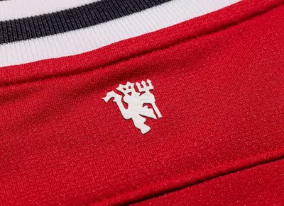 Manchester United New Jersey Logo Red Devil behind New jersey 2011-2012