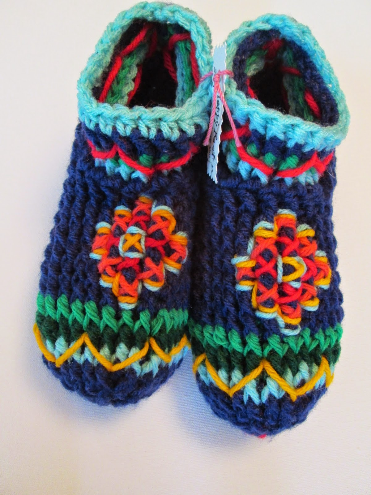 https://www.etsy.com/listing/221785671/pow-wows-crochet-moccasin-slippers