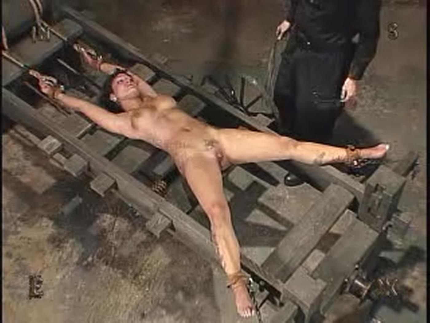 Males stretched on torture racks
