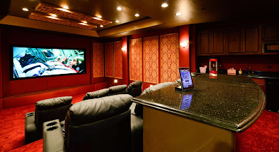 a special big room is utilized into a private home theater that occupies six comfy theater seatings and extra mini bar behind them
