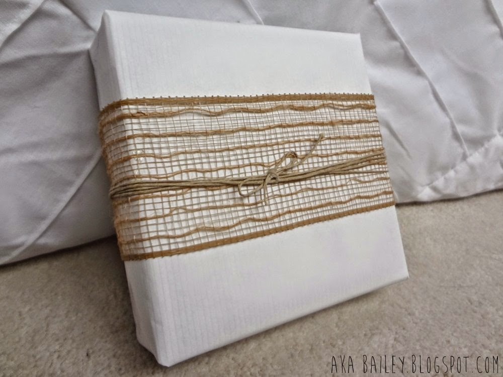 White gift wrap with burlap ribbon and hemp twine