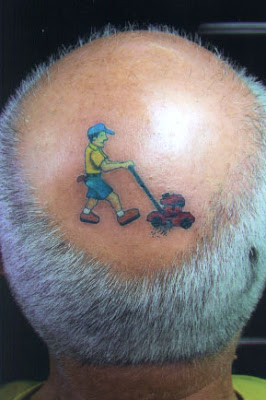 Lawnmower on the head tattoo