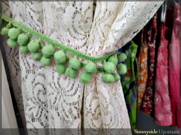 Use pom fringe as a curtain tie back