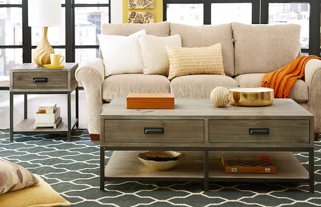 laminate wood parsons coffee table with double drawers and open shelves in the living room beside the loveseat sofa