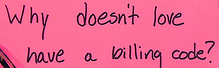 Pink paper with question handwritten in black ink