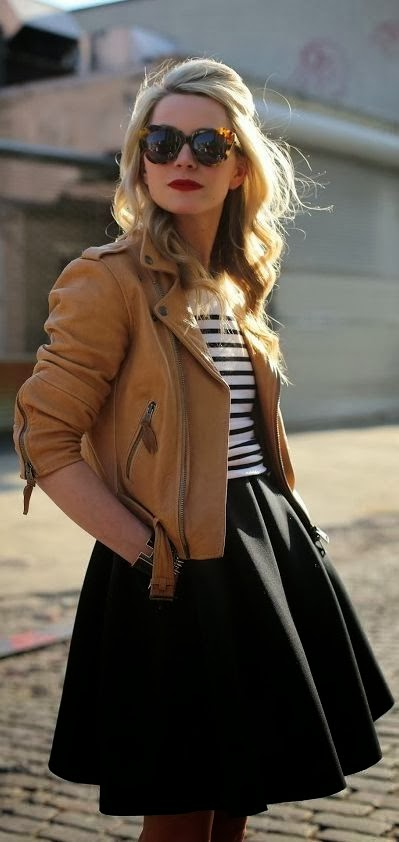 Brown leather jacket, black lined blouse and black skirt