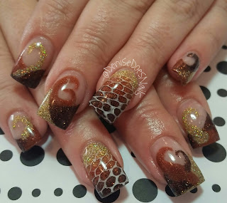 fall swirl nails with snakeskin