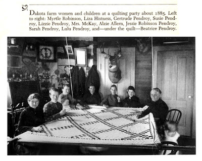 Dakota women and children at a quilting party about 1885