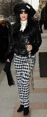 Cher in black and white trousers