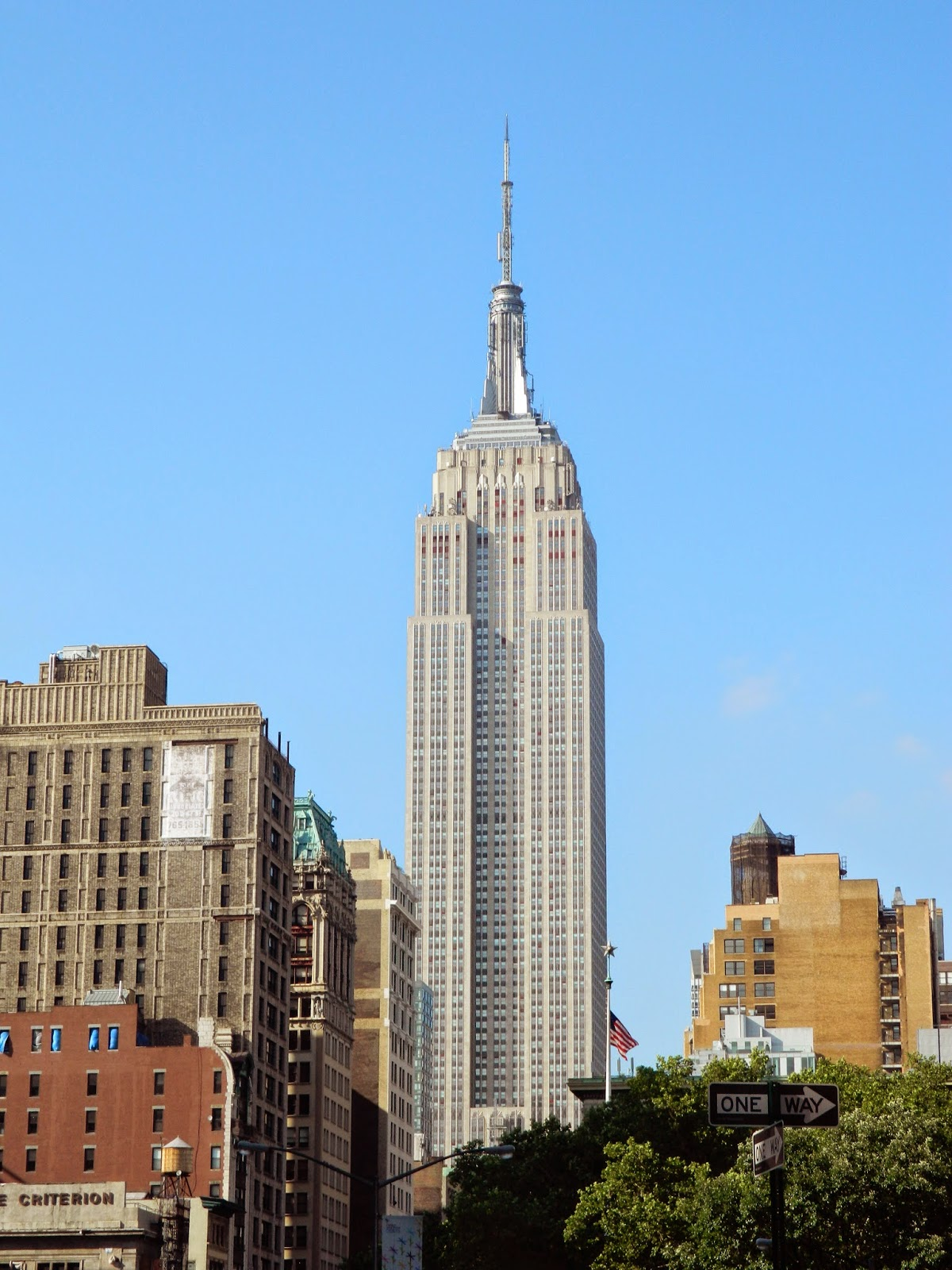 new york city empire state building sky blue summer tall architecture
