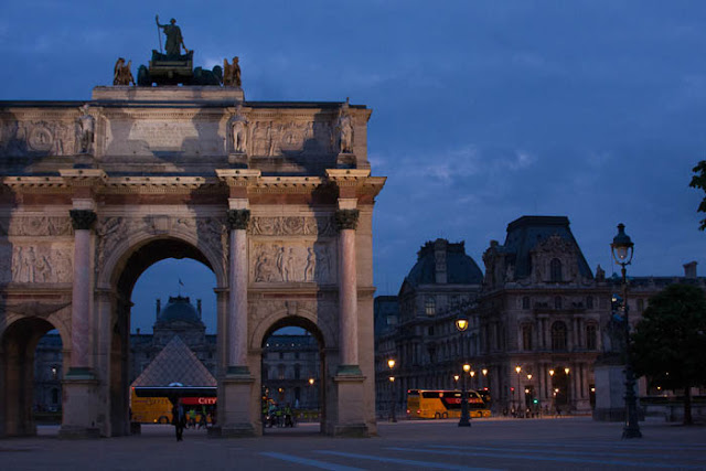 Louvre and Arc de Triomphe du Carrousel by lamplight
