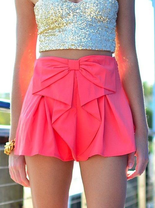Bright pink skirt with shinning golden blouse