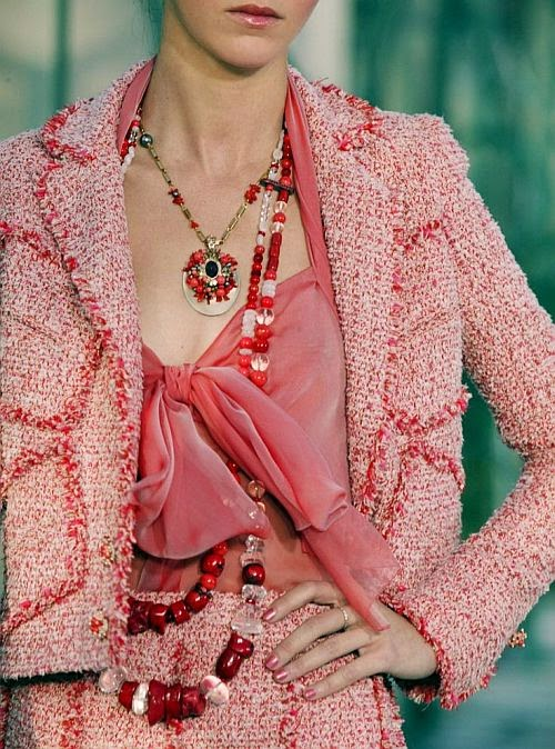 Chanel runway details: warm coral tweed suit with necklaces