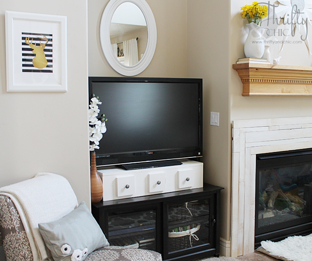 TV Storage Stand Tutorial -great way to raise your TV and hide your remotes!