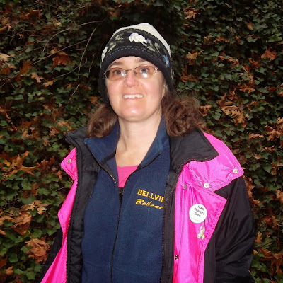 "Cynthia Parkhill wearing ""Bellview Bobcats"" zip-up fleecy vest"