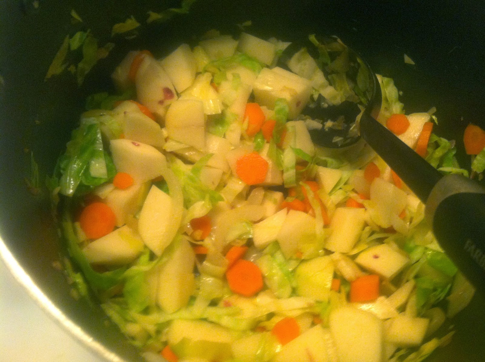 Cabbage, Potatoes and Carrots getting stirred up for some Irish soup. Cooking Chat recipe.
