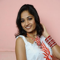 Madhavi latha looking Suave Shy in white saree
