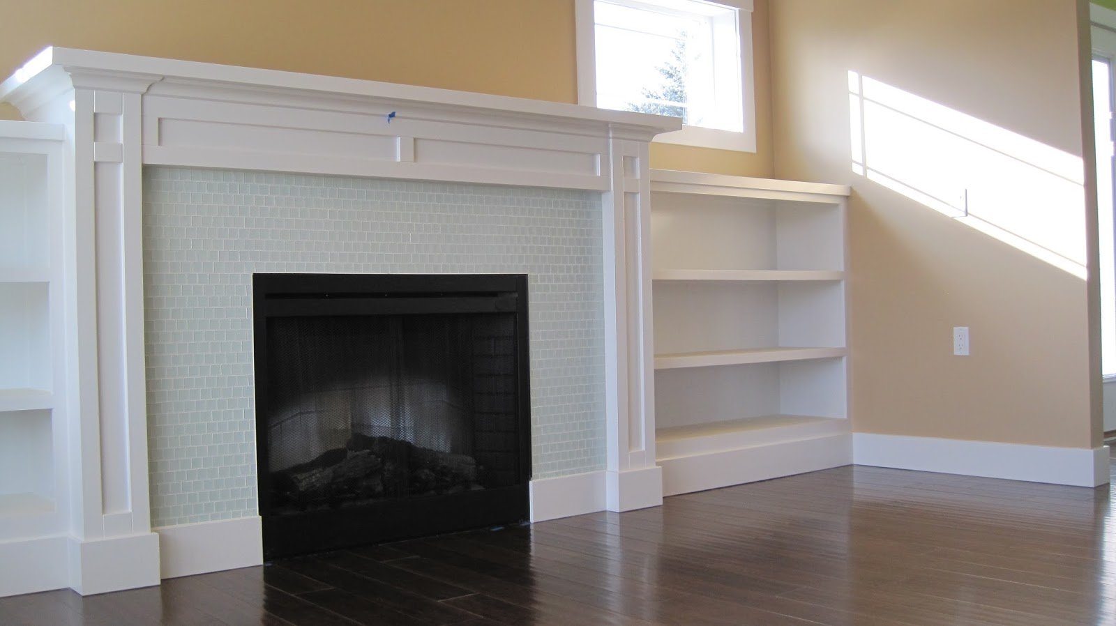 Amazing photo of hardwood floors fireplace with built in shelves.JPG with #766755 color and 1600x898 pixels