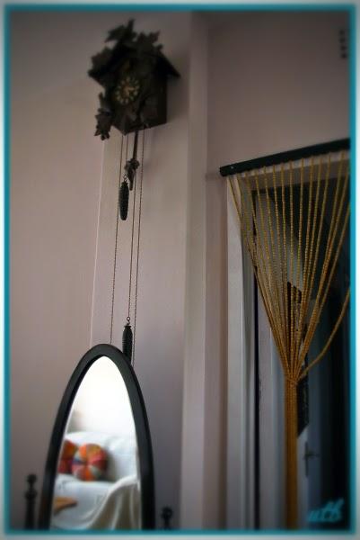 vintage-mirror-cuckoo-clock-beaded-curtain