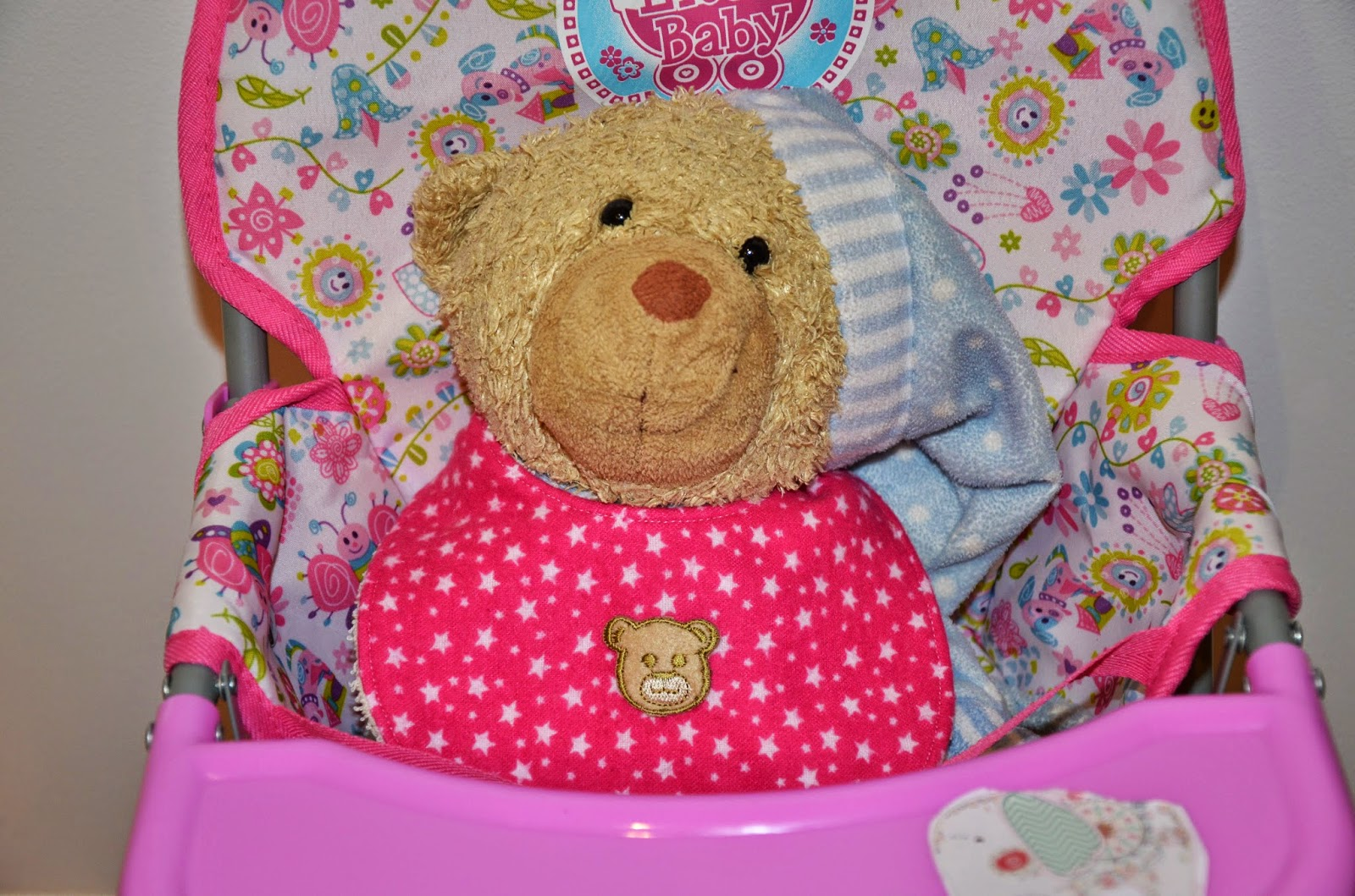 teddy in a highchair