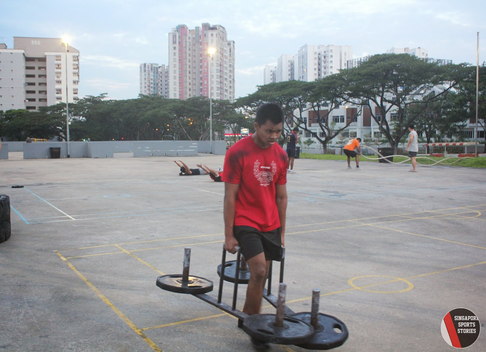 Members of Singapore Strongman group, SG Titans, performing the farmer's walk